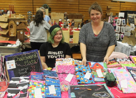 Journalist and artist Tory Jones (right) returned to Fort Kent, along with her daughter Sarah Bonenfant, to sell homemade chalk mats, jewelry and braided ribbon barrettes at the Fort Kent Arts  Craft Fair during the weekend of November 26-27, 2016. Jessica Potila | SJVT / FhF)