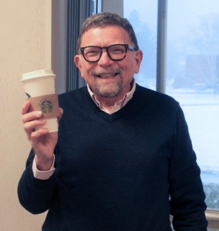 """University of Maine at Fort Kent President John Short, who describes Starbucks as """"an experience"""" enjoys a Starbucks coffee in his office on Tuesday, Nov. 29, 2016. (Jessica Potila 