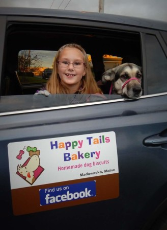 Brooke Levesque, 8, of Madawaska, seen here with Sasha, started her own dog treat business in the fall of 2016.   (Contributed photo)