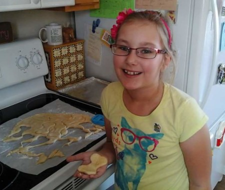 Brooke Levesque, 8, of Madawaska, makes dog treats in her familys kitchen. Contributed photo)