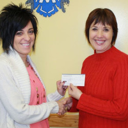 The Madawaska Education Association, made up of teachers and support staff, have made a $500 donation to the Band Boosters for the Pride of Madawaka's trip to Washington, D.C., for the presidential inauguration. The membership feels it is a worthy educational opportunity for the students. Jenny Bechard, right, secretary/treasurer of the association, presents the check to April Leclair, a member of the boosters club. (Contributed photo)