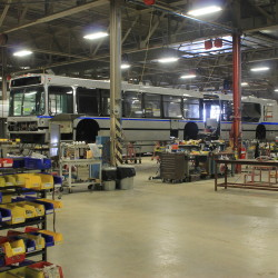 A Massachusetts Bay Transportation Authority bus being serviced can be seen on Sept. 28, 2016, at the Maine Military Authority's facility at the Loring Commerce Centre in Limestone. (Anthony Brino | Staff Writer)