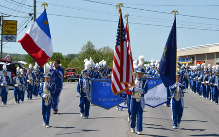 The Pride of Madawaska Marching band, seen here at a 2102 Memorial Day parade in Madawaska, Maine, has been invited the 58th Presidential Inauguration in Washington, D.C. (SJVT / FhF image)