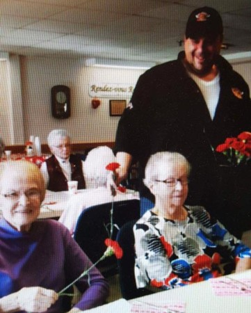 """Big Rick"" Nadeau delivered pizza and flowers to residents at Le Maison Acadienne in Madawaska on Valentine's Day, 2017. (Contributed photo)"
