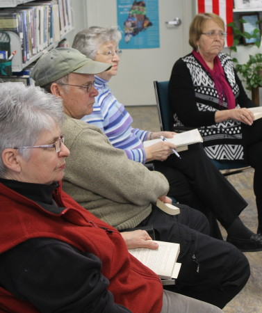 "Avid readers, from left, Terry ""T.O."" Ouellette, James Chasse, Jackie Ayotte and Maine Humanities Council scholar Jan Grieco discuss the ""Let's Talk About it"" book club offering, Saturday, Feb. 11 at the Long Lake Public Library in St. Agatha. (Don Eno 