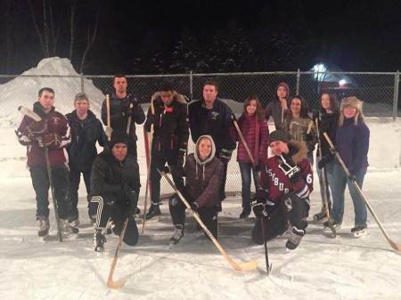 Ukrainian George Safonov, front right, a UMFK sophomore, teaches hockey lessons at the Fort Kent ice rink in January, 2017. Contributed photo)