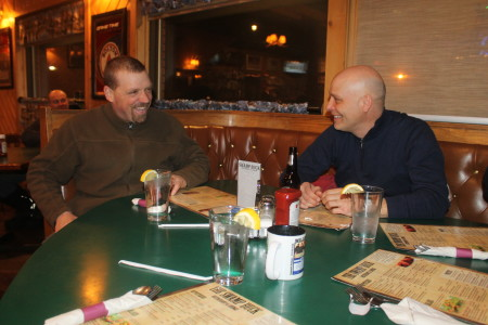 Martin Massicotte, right, and Denis Tremblay share Can Am stories and others at the Swamp Buck in Fort Kent on Thursday, March 2. (Jessica Potila | SJVT/FhF)