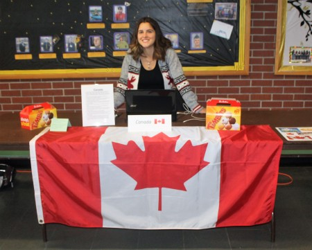 University of Maine at Fort Kent student Catherine Bruno, originally from Montreal, shared donut holes and information about her home country at an international students forum at UMFK on Thursday, March 2. (Jessica Potila | SJVT/FhF)