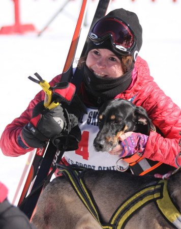 Marie Parent gives her dog a hug after crossing the finish line at the 6K skijoring races at Fort Kent Outdoor Center, Sunday, March 5. (Don Eno | SJVT/FhF)
