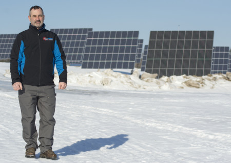 Dale Roy, of Maine Solar and Wind, recently installed a private Solar Farm for Neal Griffeth to use for his local businesses. The farm, located on the Van Buren Road in Caribou, contains 945 panels with the capacity to produce 247 kilowatts of energy per hour. (Christopher Bouchard | BDN)