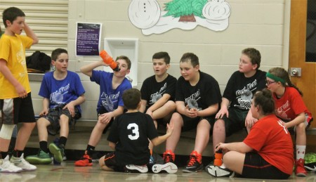 Fort Kent Parks and Recreation Department volunteer Coach Robert St. Germain said seeing kids compete with one another on the basketball court and then gather as friends in-between games is what rec basketball is all about. From left (back): Ethan Daigle, Lance Gagnon, Keegan Cyr, Pierson Caron, Nathan Dionne, Alex Nadeau and Larissa Daigle. Upfront: Blake Beaulieu and Gracie Landry. (Jessica Potila | SJVT/FhF)