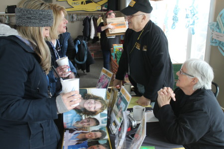 Joel and Rinette Jandreau, volunteers with Patient Air Lift Services, talk with people at Angel Snowfest, Saturday, March 11, at the Lakeview Restaurant in St. Agatha. PALS is one of three organizations for which Snowfest raises funds. (Don Eno | SJVT/FhF)