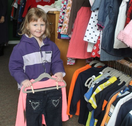 Three-year-old Charlotte Lake found some good bargains on gently used name-brand clothing while shopping with her mother Lauren at the new Little Daniel's Den store in Fort Kent on Monday, March 13. (Jessica Potila | SJVT/FhF)