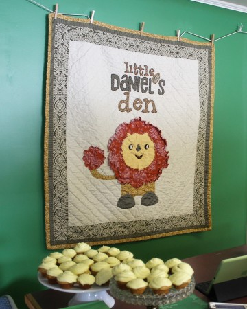 Melanie Daigle, owner of Little Daniel's Den in Fort Kent, custom created a quilt which hangs behind the counter of the store on Monday, March 13. (Jessica Potila | SJVT/FhF)