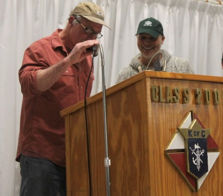 Can-Am Crown 250 Race Marshal Don Hibbs, left, helps translate a speech from French to English for champion musher Martin Massicotte at an annual awards banquet for the international sled dog race on Tuesday, March 7 at the Knights of Columbus Hall in Fort Kent. (Jessica Potila | SJVT/FhF)