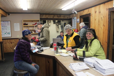 Volunteers Sylvia Dow-Harvey, left, Frances LaBrie, center, and Tonya Michaud work with checkpoint staff out on the route while at Can-Am headquarters at Lonesome Pine Trails lodge. (SJVT/FhF photo | Don Eno)