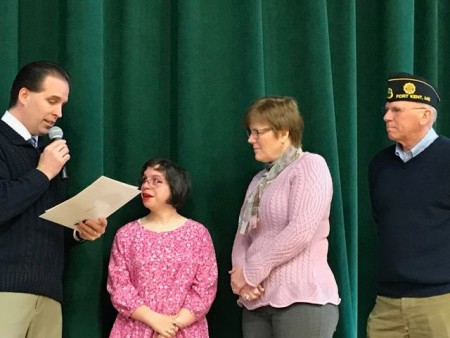 Principal James Charette presents Fort Kent Community High School student Sophie Saunders with a President's Volunteer Service Award at a special assembly at the school on Monday, March 6. From left: Jay Charette, Sophie Saunders, Kelly Martin, George Dumond.   (Staff photo   Jessica Potila)