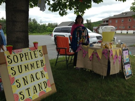 Sophie Saunders exercised her entrepreneurial talents on Saturday, July 9, managing a summer snack stand to raise funds for the cat rescue organization PAWS. (Contributed/Jeannie Nadeau)