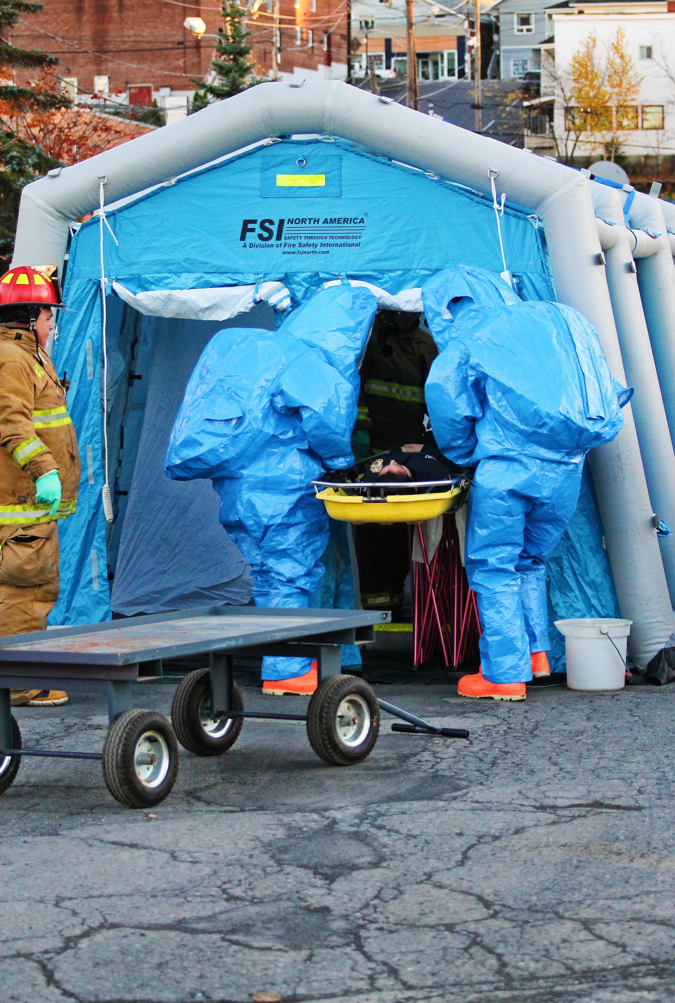 Emergency responders in hazmat suits pass a u201ccontaminatedu201d victim through a portable decontamination tent during Wednesdayu0027s training exercise in Madawaska. & Multiple agencies respond to hazmat exercise temporarily close ...