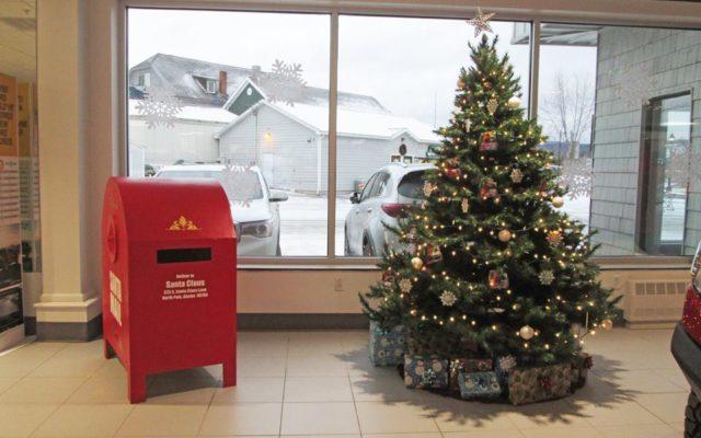 Santa installs mailbox to north pole at valley motors for Valley motors fort kent