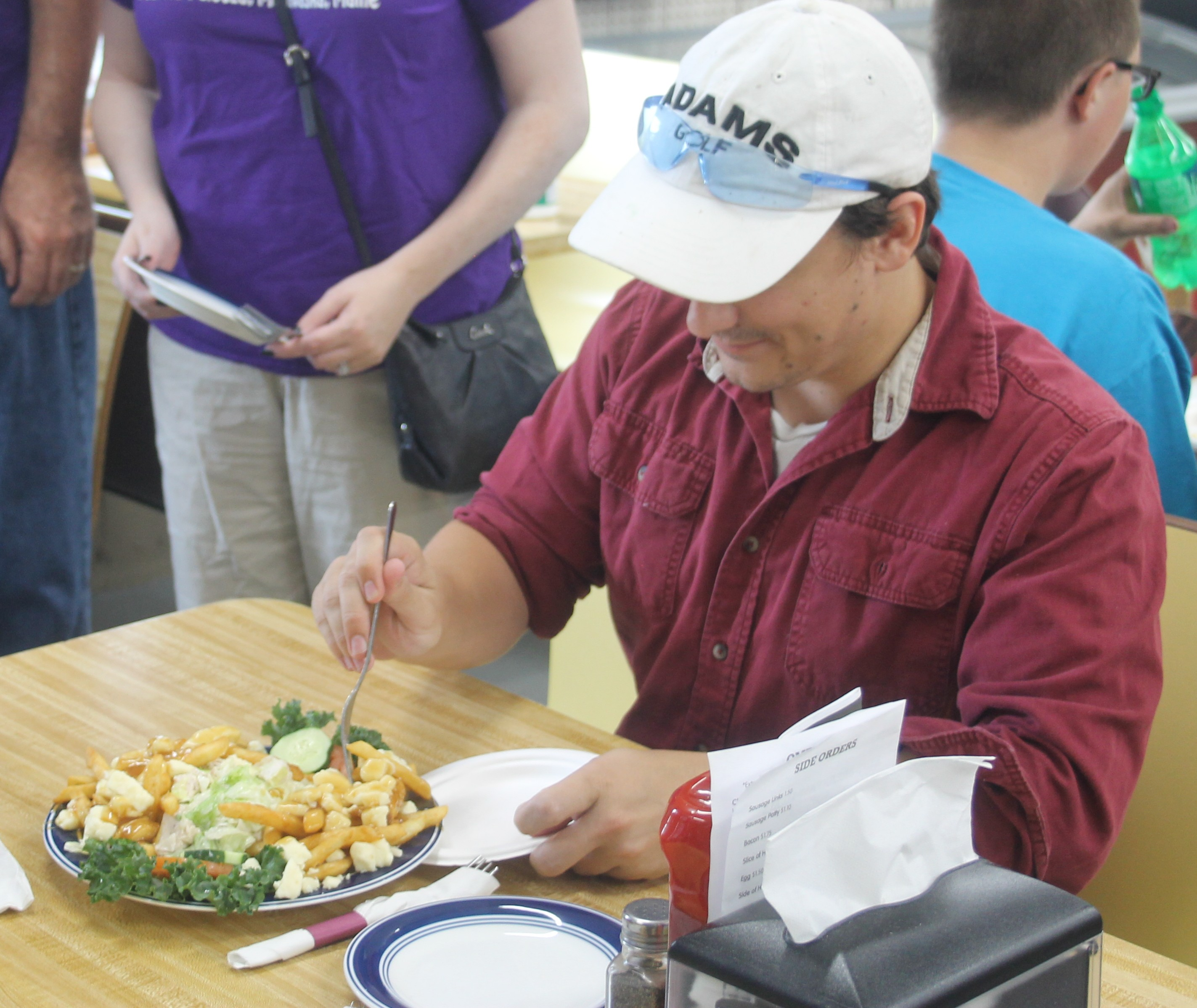 Judges Assess Entries In Search For Best Poutine In St John Valley