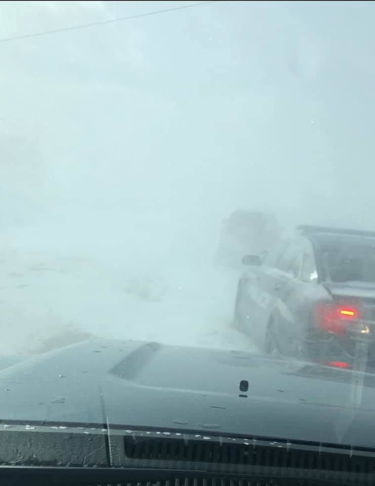 High winds, blowing snow shut down roads, schools